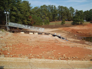 In Atlanta and Athens, Georgia, 2007 was the second driest year on record. Among the numerous effects of the rainfall shortage were restrictions on water use in some cities and low water levels in area lakes. In the photo, a dock lies on dry land near Aqualand Marina on Lake Lanier (located northeast of Atlanta) in December 2007.