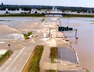 The Great Flood of 1993 caused flooding along 500 miles of the Mississippi and Missouri river systems. The photo shows the flood's effects on U.S. Highway 54, just north of Jefferson City, Missouri.